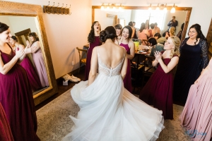bride twirling in front of bridesmaids at stonecrest