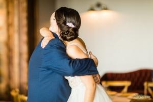 father of bride hugging daughter stonecrest