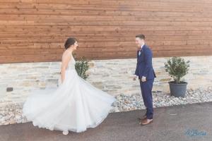 bride twirls for groom during first look stonecrest