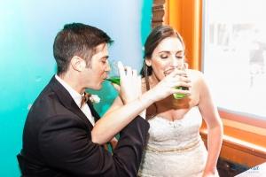 bride groom drinking green beers