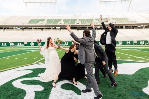 Wedding Party Playing Football Colorado State Football Field