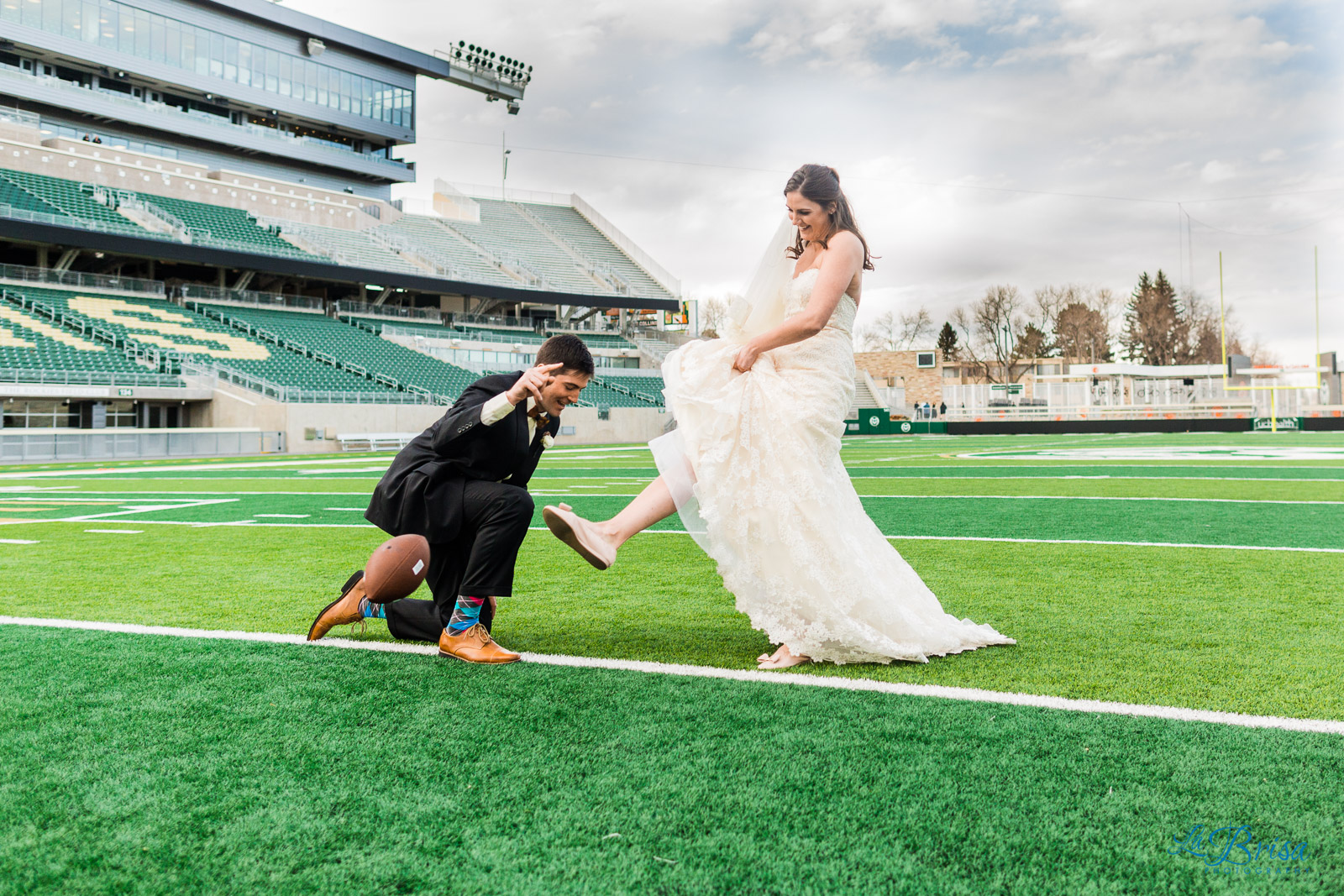 Bride kicking field goals groom placeholder colorado state football stadium