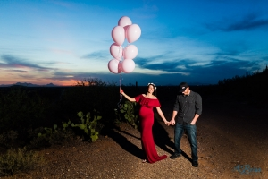 pink balloons gender reveal red maternity dress