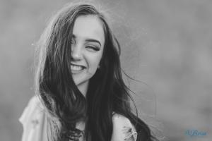 laughing hair in face senior portrait pose