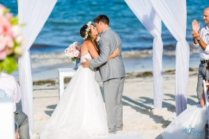 bride groom first kiss cancun beach wedding