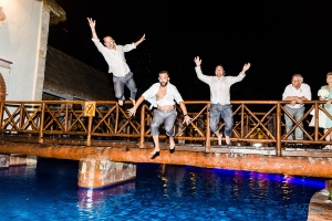 jumping into pool Now Sapphire Riviera Cancun wedding
