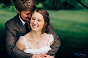 Bride and groom snuggling pose wedding portrait wayne nebraska