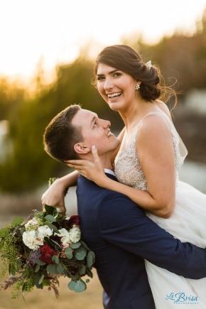 Groom lifting bride with bouquet stonecrest wedding