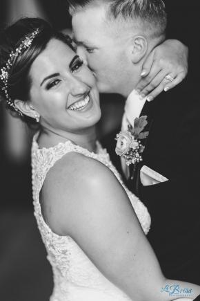 Rustic Cooper Barn Wedding Groom Kissing Bride